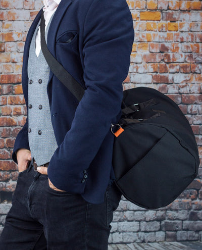 Vanacci canvas duffle bag worn by a man