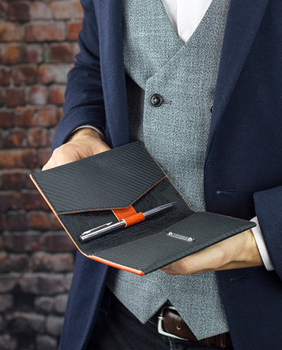 Vanacci Travel Wallet in the hands of a business travel man