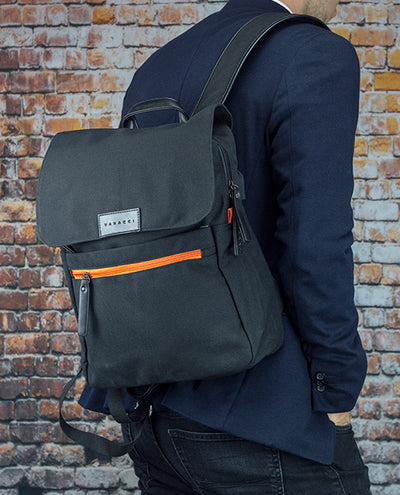 Vanacci canvas laptop backpack in black and orange on a man