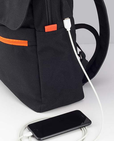 Vanacci canvas laptop backpack in black and orange charging phone