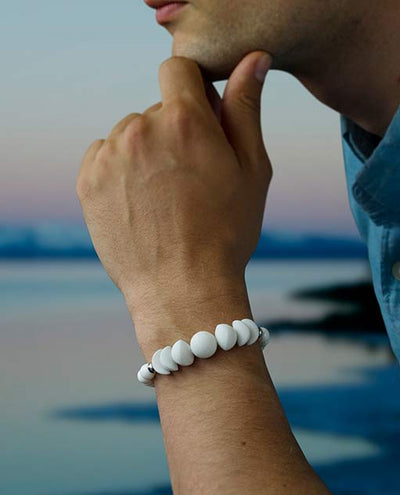 Vanacci Lockstone All White Perfume Bracelet worn on a man