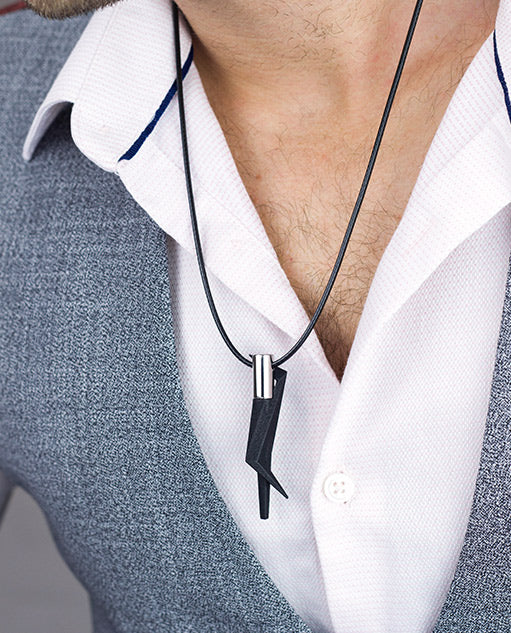 Vanacci Geo Pendant in black and stainless steel on a black necklace