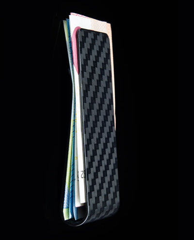 Solid Carbon fibre money clip by vanacci holding cash and cards