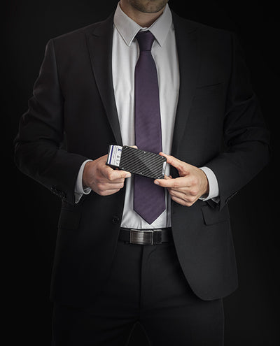 Vanacci Stealth 3 wallet with shiny carbon fiber held by a man