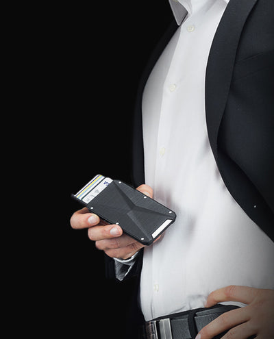 Vanacci Stealth 3 wallet held by a man in smart attire.