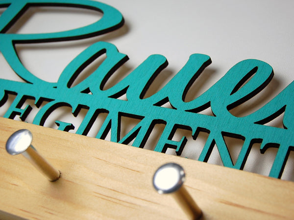 """Rauen"" key hook display in turquoise text on a clear base"