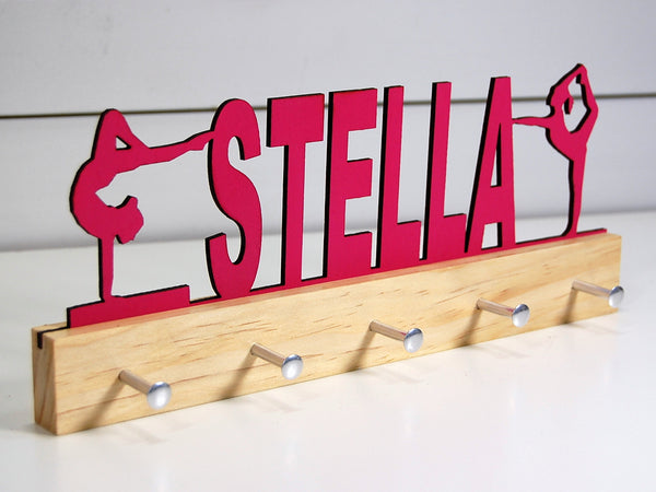 "Pink ""Stella"" customized medal holder on a clear base"