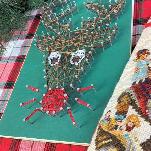 products/Pinecone_Home_Rudolph_String_Art_on_plaid_SQ.jpg