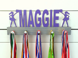 Our personalized cheerleader medal holder is a unique gift for the cheerleader in your life. This display will be the perfect way for her to show off all of her well-deserved awards. This design comes in a variety of colors, or you can pick from our other choices of sports or phrases so we can customize it just the way you want!