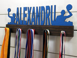 Our personalized water polo medal holder is a unique gift for any water polo player so they can display all of their awesome and well-deserved awards. This design comes in a variety of colors, or you can pick from our other choices of sports or phrases so we can customize it just the way you want!