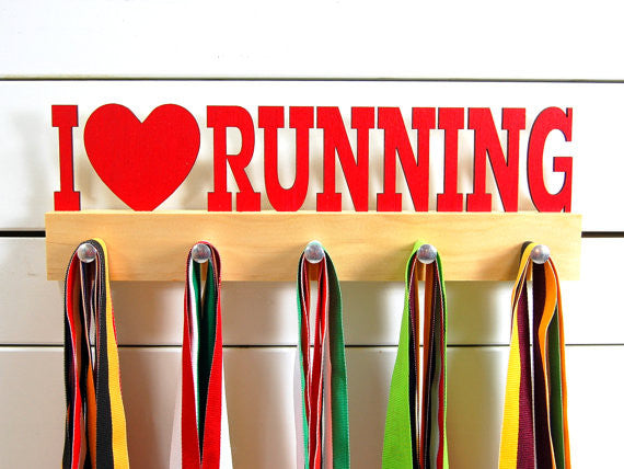 Our running medal holder is the perfect gift for anyone who loves running as much as we do! This display will help them show off all of their well-deserved awards. This design comes in a variety of colors, or you can pick from our other choices of sports or phrases. Better yet, tell us your own personal mantra so we can customize a unique medal holder just for you!
