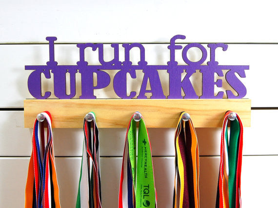 Our running medal holder is the perfect gift for any runner who has their priorities straight. This design comes in a variety of colors, or you can pick from our other choices of sports or phrases. Better yet, tell us your own personal mantra so we can customize a unique medal holder just for you!