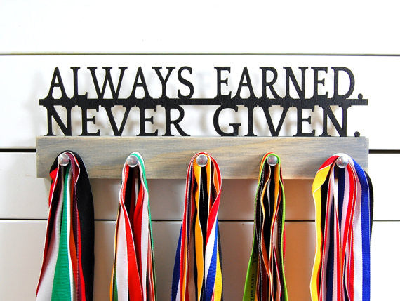 This medal holder is a great gift for any athlete so they can show off all of their awesome awards. This design comes in a variety of colors, or you can pick from our other choices of sports or phrases. Better yet, tell us your own personal mantra so we can customize a unique medal holder just for you!