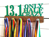 Our half marathon running medal holder is a great gift for any runner so they can display all of their awesome awards. This design comes in a variety of colors, or you can pick from our other choices of sports or phrases. Better yet, tell us your own personal mantra so we can customize a unique medal holder just for you!