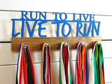 Our running medal holder is a great gift for any dedicated runner so they can display all of their awesome awards. This design comes in a variety of colors, or you can pick from our other choices of sports or phrases. Better yet, tell us your own personal mantra so we can customize a unique medal holder just for you!