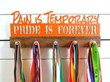 Our medal holder is a great gift for any dedicated athlete to show off all of their awesome awards. This design comes in a variety of colors, or you can pick from our other choices of sports or phrases. Better yet, tell us your own personal mantra so we can customize a unique medal holder just for you!