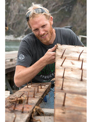 Martijn Stiphout of Ventana Surfboards inspecting Doug fir hull wood from the Western Flyer