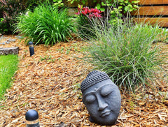 Buddha Face sculpture in the garden