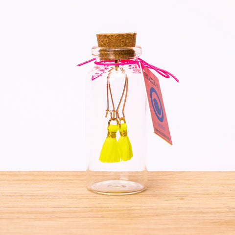 tassel earrings in glass bottle