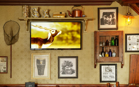 typical irish bar, pub, pictures on wall, bar in ireland