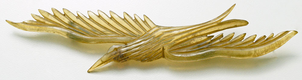 Carved horn bird brooch. French Art Nouveau.