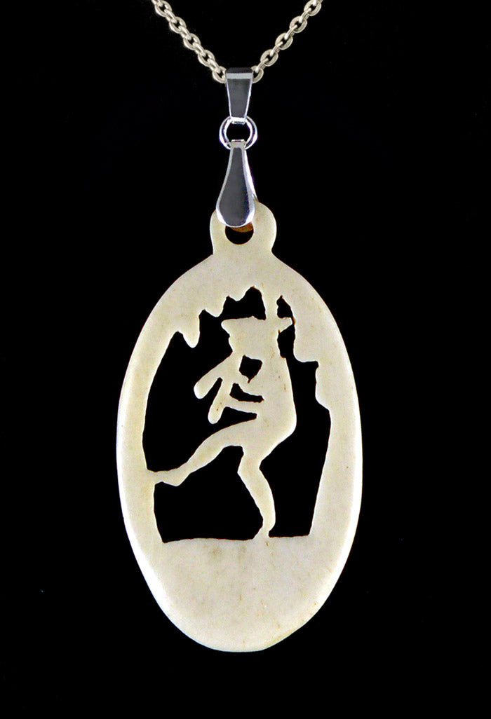 Pan the Piper carved antique pendant. Hand carved bone
