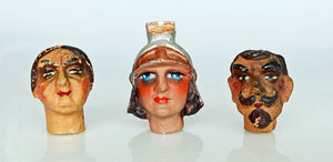 Antique puppet heads. Bizarrely interesting!