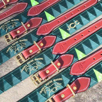 Boy-O-Boy Bridleworks custom satin and grosgrain Stirrup Buckle belts with logo embroidery.