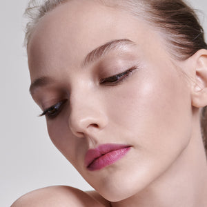 model wearing tinted lip balm