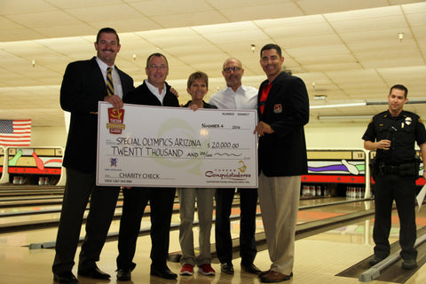 Special Olympics of Arizona being presented with a check