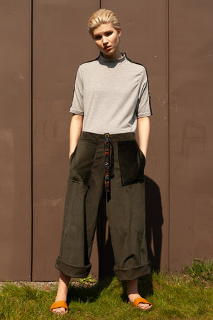 front view of model wearing sustainable clothing outfit - organic cotton and bamboo hand embroidered t-shirt with wide leg cropped organic cotton corduroy trousers