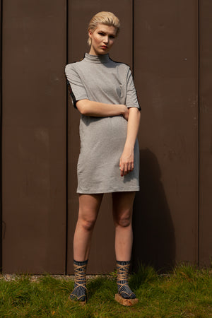 model wears light grey hand embroidered 'choose happiness' t-shirt dress made from organic cotton and bamboo