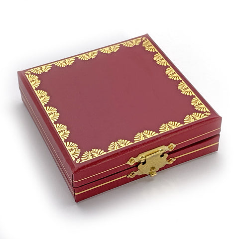closed burgundy box with gold designs