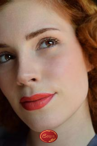 Woman With red Hair Wearing Red Lipstick by Bésame Cosmetics