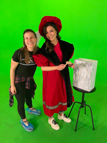 Lisa Lumar and Miranda Cosgrove in front of a green screen.