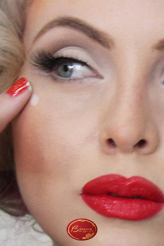 Woman wearing red lipstick and red nail polish