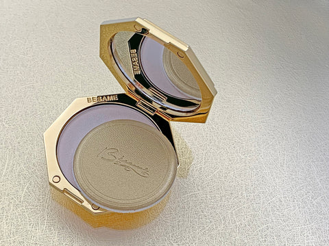 open besame signature compact on gold textured background