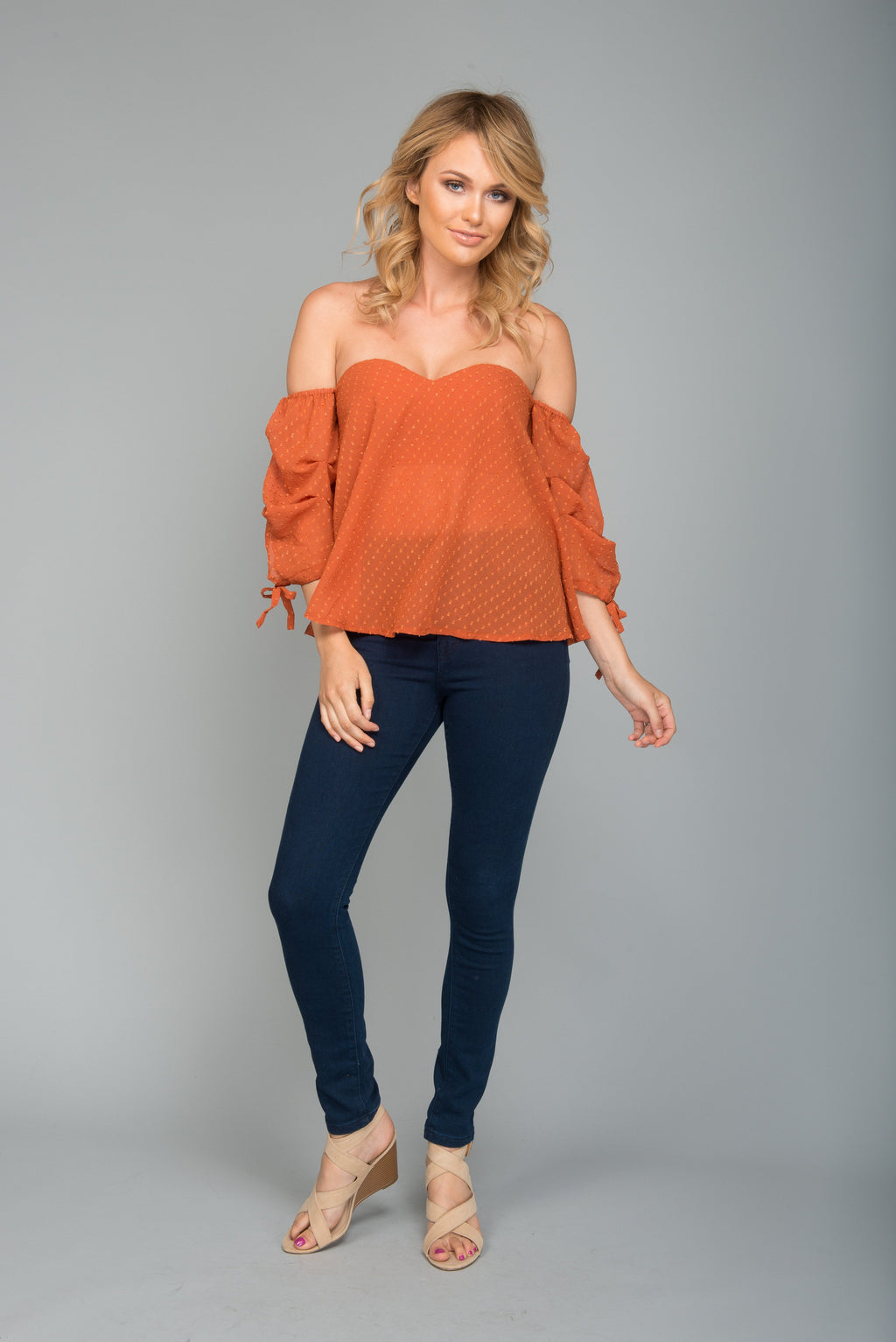 strapless off the shoulder textured polka dot top - rust