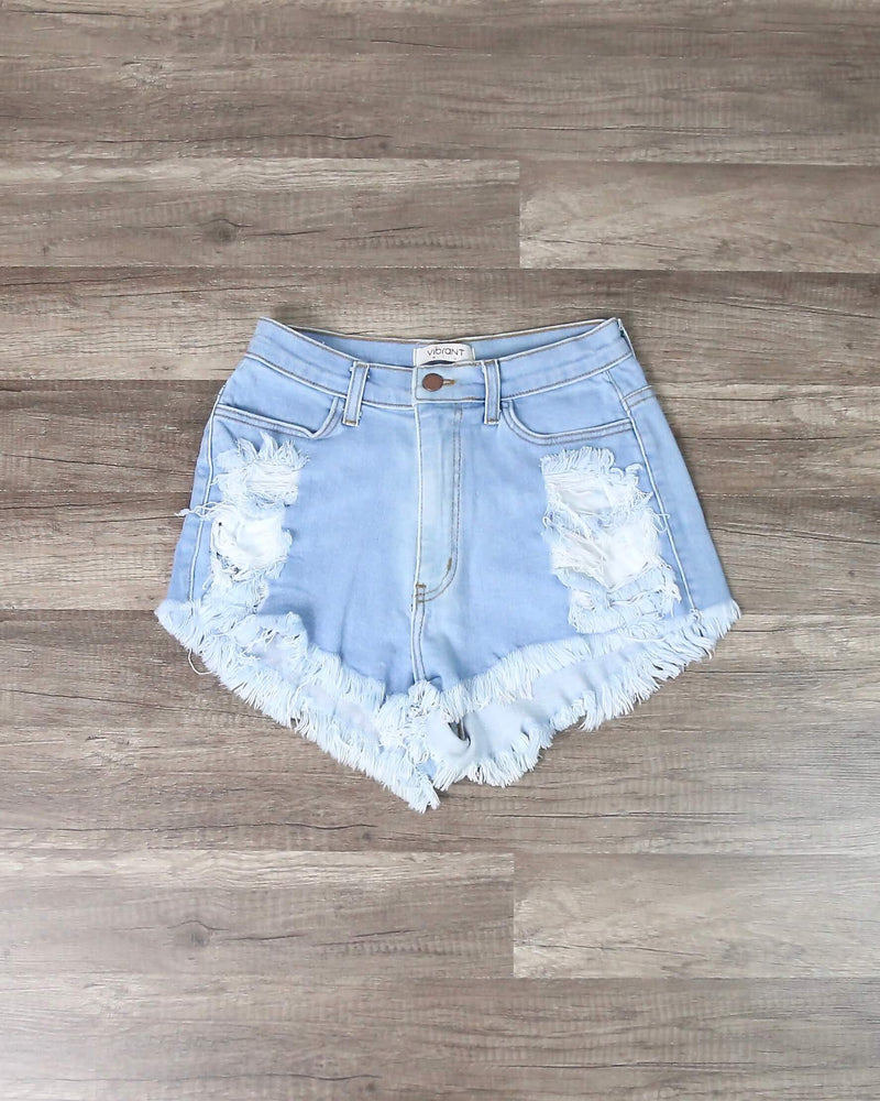 High Waisted Distressed Denim Shorts in Light Wash