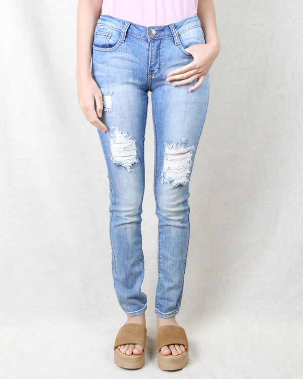 Distressed Low Rise Skinny Jeans in Medium Blue Denim Wash