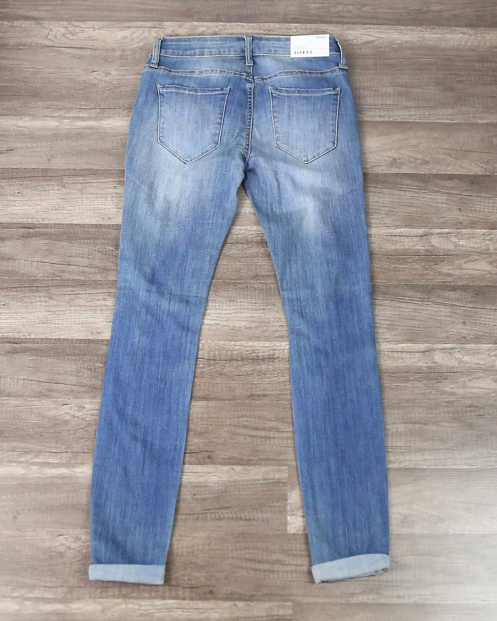Victoria Destroyed Mid Rise Rolled Skinny in Medium Wash