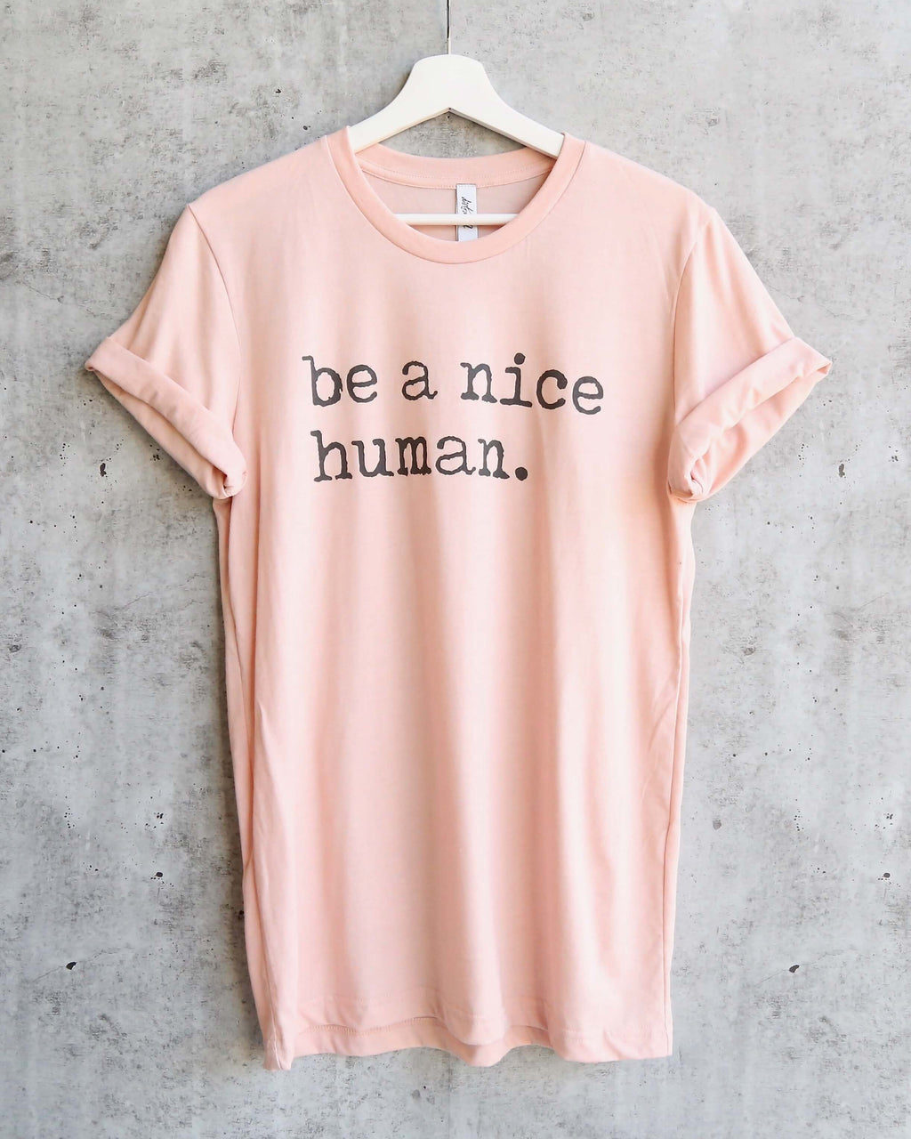 Distracted - Be a Nice Human Unisex T-Shirt in Peach