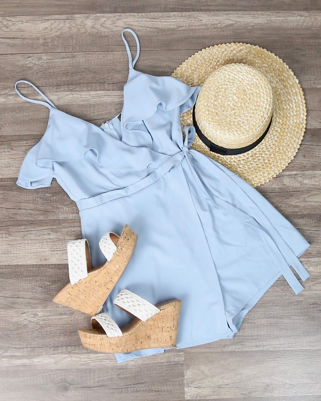 In My Feelings Ruffled Wrapped Sleeveless Romper in Sky Blue