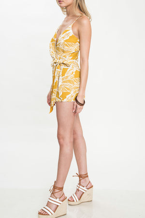 dripping in finesse - leaf print wrap romper - yellow