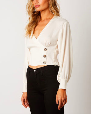 cross over fitted satin top with cuff sleeves - ivory