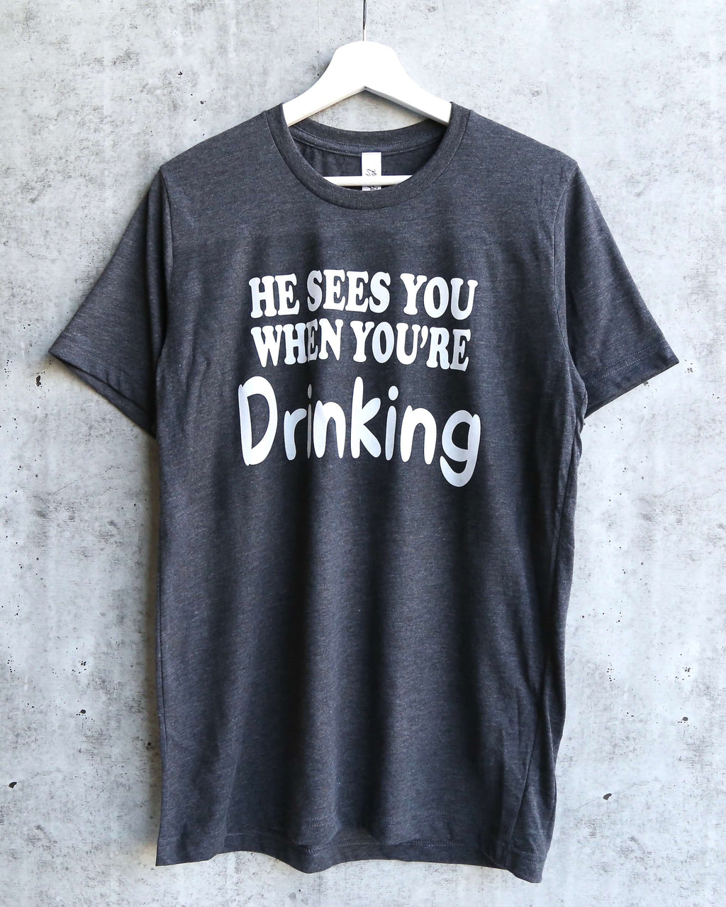 Distracted - He Sees You When You're Drinking Christmas Unisex Graphic Tee in Dark Heather Grey