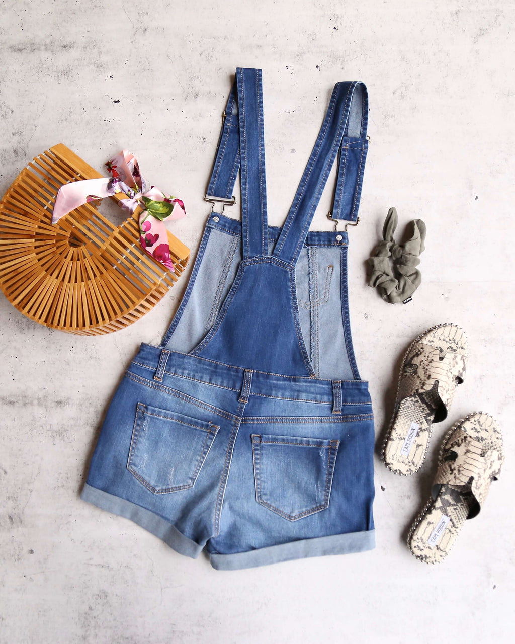 distressed rolled cuff button down shortall in medium wash denim