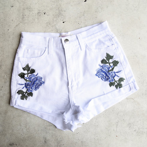 high waisted shredded hot shorts with floral applique - white