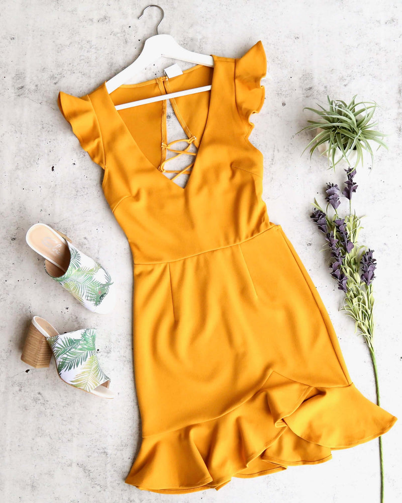 girl next door ruffle sleeve tie back mini dress in mustard