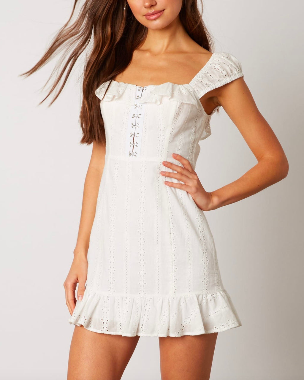 hook and eye front closure with ruffled trim eyelet mini dress in white
